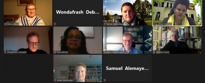 Ambassador Mulu Solomon discusses with university professors and researchers.